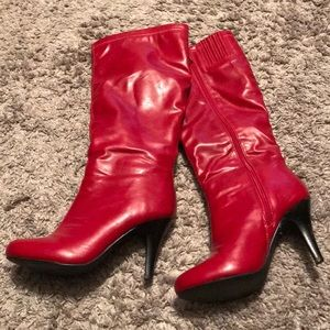 Red knee high heeled leather boots